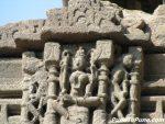 Goddess in mini temple on the shikhara