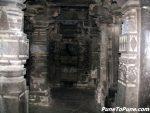 Corridor with ornamented pillars